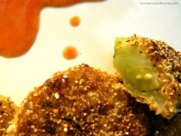 Fried green tomatoes with hot sauce splash