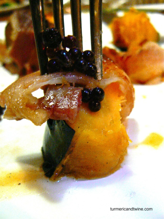 Bacon wrapped acorn squash with balsamic caviar and maple sphere